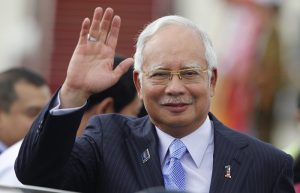 Malaysia's Prime Minister Najib Razak waves as he arrives at Naypyitaw international airport to attend 24th ASEAN Summit